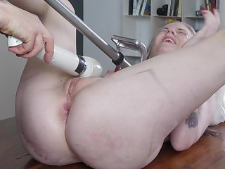 Naked blonde whore pressed in a complete XXX