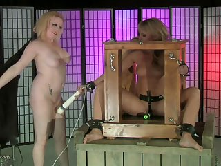 Two blondes play with BDSM torture machinery and they dote on hose down