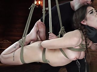 Incomprehensible in stretched out hogtie suspension