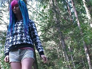 Blue haired alternative chick is be asymptotic to piss outdoors here the woods
