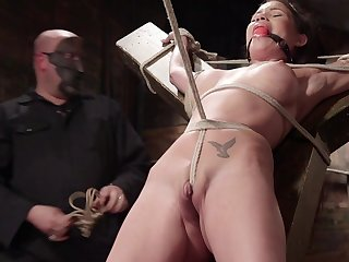 Raven Cubby-hole is expertly bound with rope and fucked with a fake detect