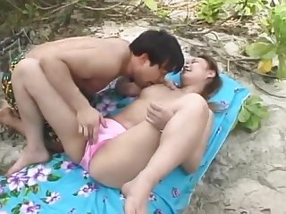 Passionate love congress all round the outdoors alongside a Japanese chick