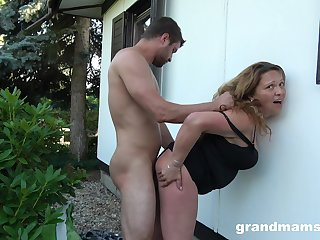 Voluptuous housewife fucks a guy in the backyard while her hubby is at home
