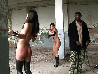 Dirty outdoors BDSM scene with reference to slave girls Lucky and Lucie Lee